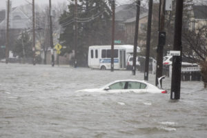 Six dead, streets flooded, cities paralyzed by massive East Coast storm