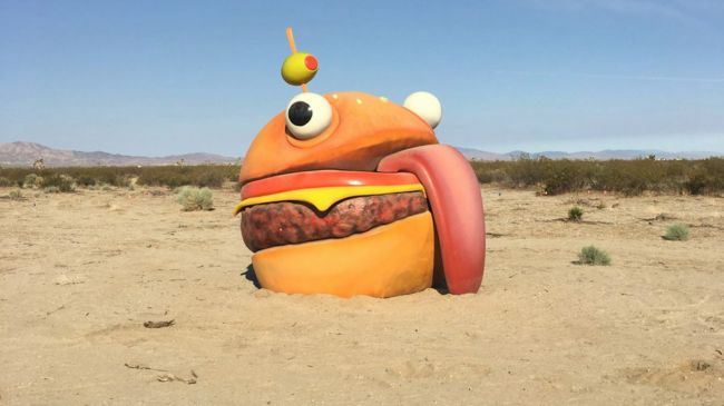 Fortnite's Durr Burger mascot found in a real-world desert after being devoured by an in-game rift